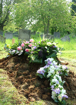 flowers on a grave at All Saints Warlingham